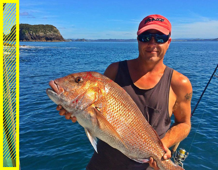 The photo showing an angler holding a pink snapper