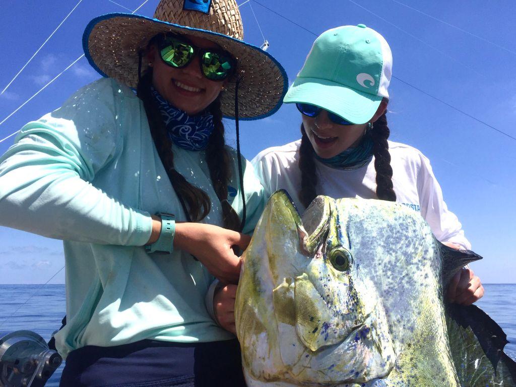 Amanda and Emily Gale holding a huge Mahi Mahi