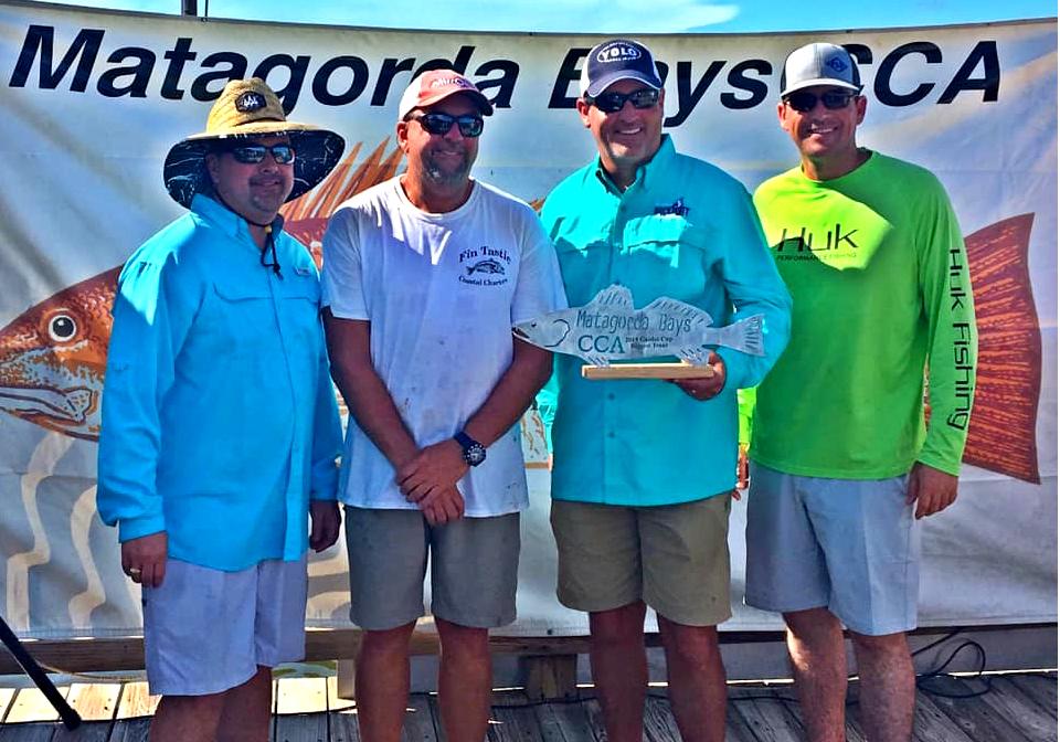 Four men holding a trout trophy