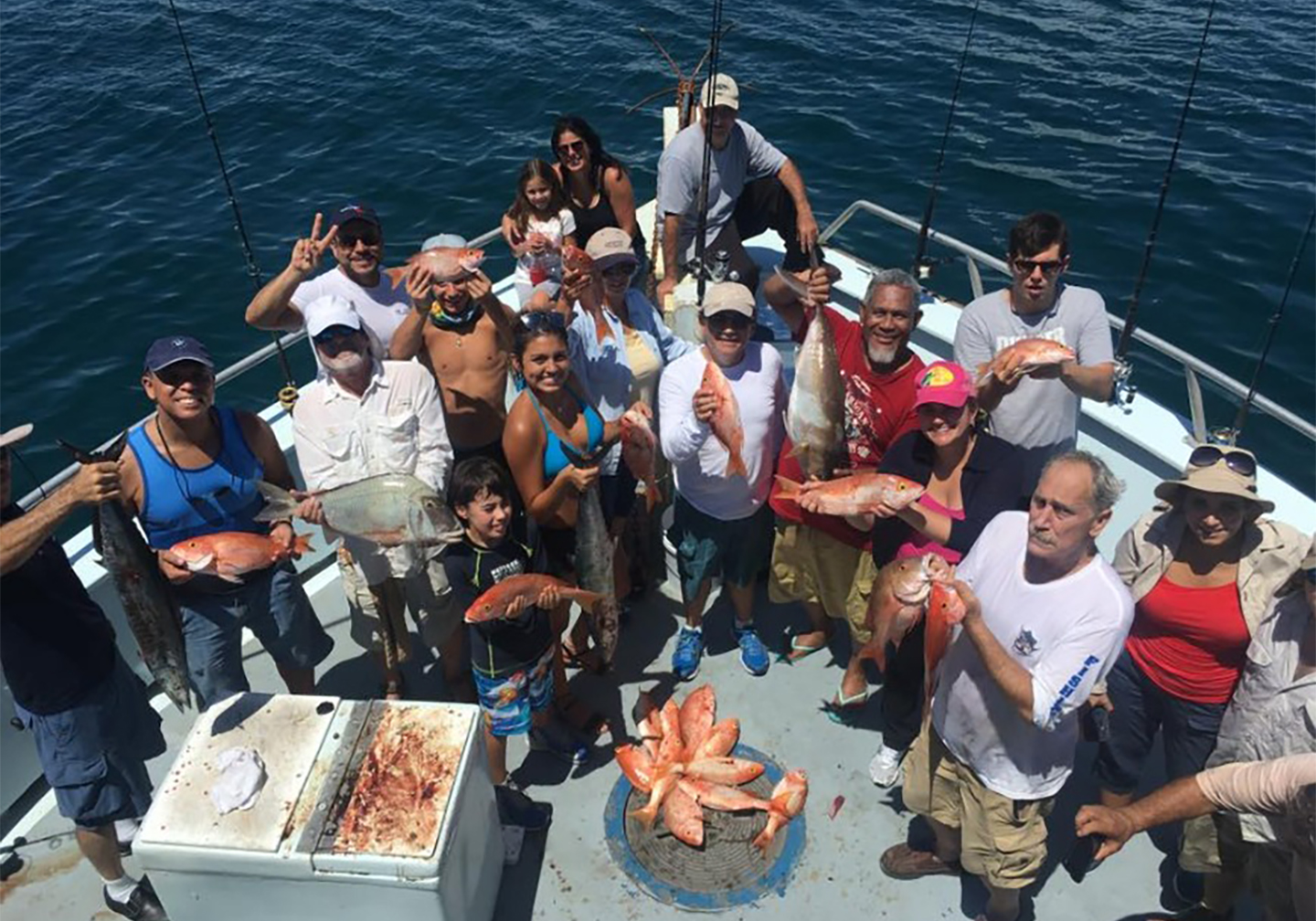 A large group of people with Red Snapper aboard a shared charter.