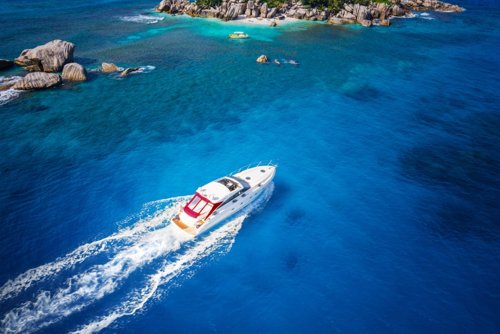 luxury fishing boat speeding through the water