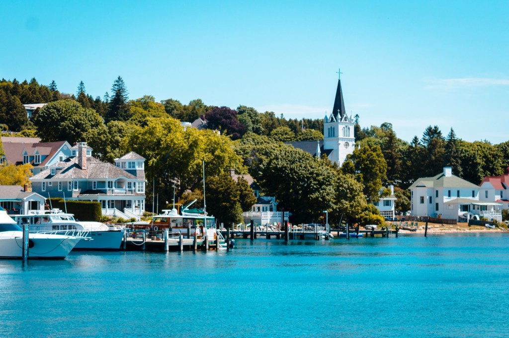 The marina on Mackinac Island, with trees and a church in the distance