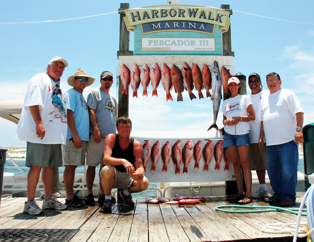 A group of anglers posing with lots of Snapper and a King Mackerel they caught at the Destin Fishing Rodeo