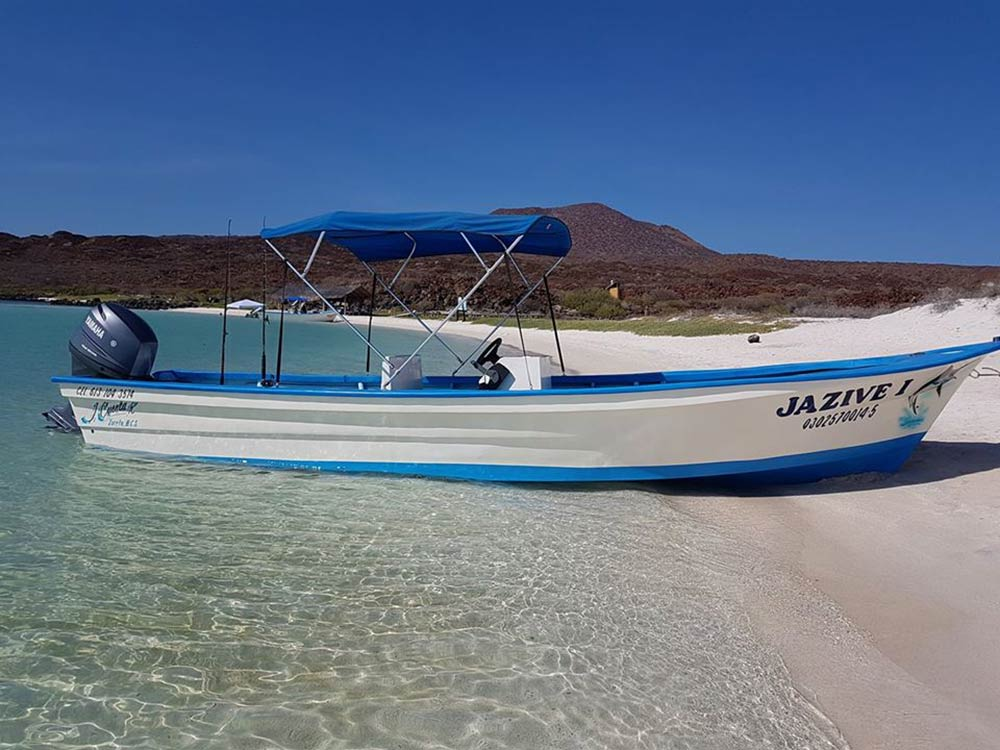 A panga boat lies in the sands in Baja California Sur