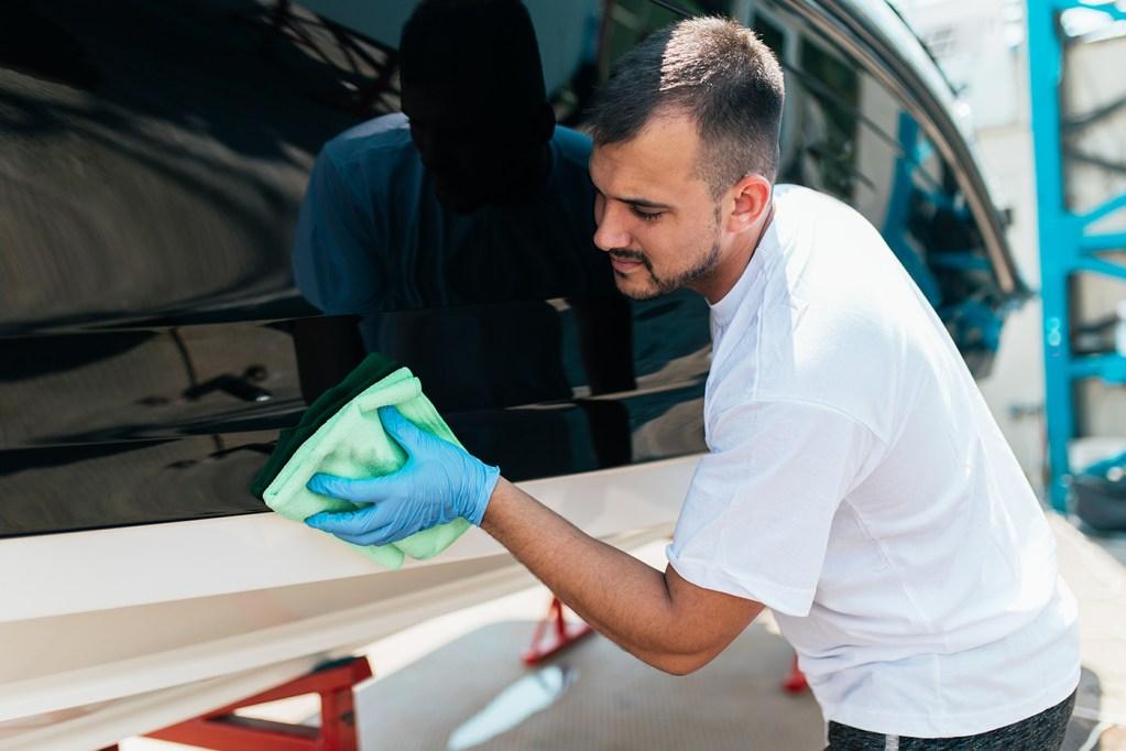 Man polishing boat