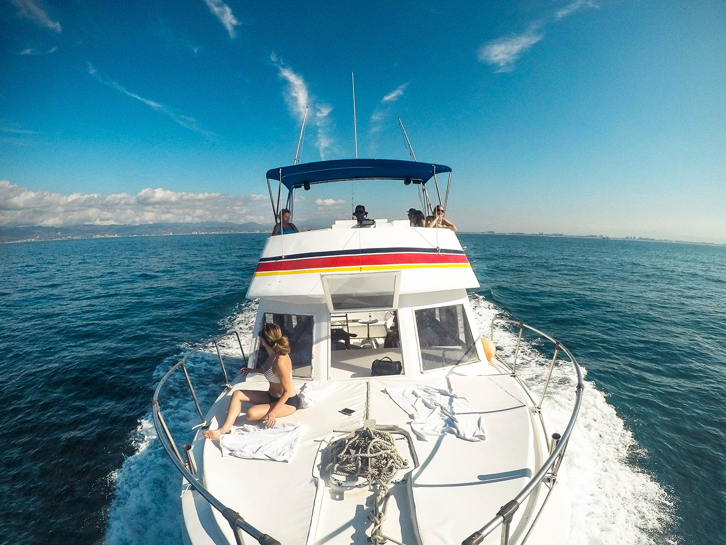 Anglers relax on the way out to sea from Puerto Vallarta on a fishing charter
