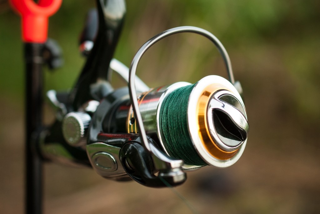 a closeup of a reel with a braided fishing line