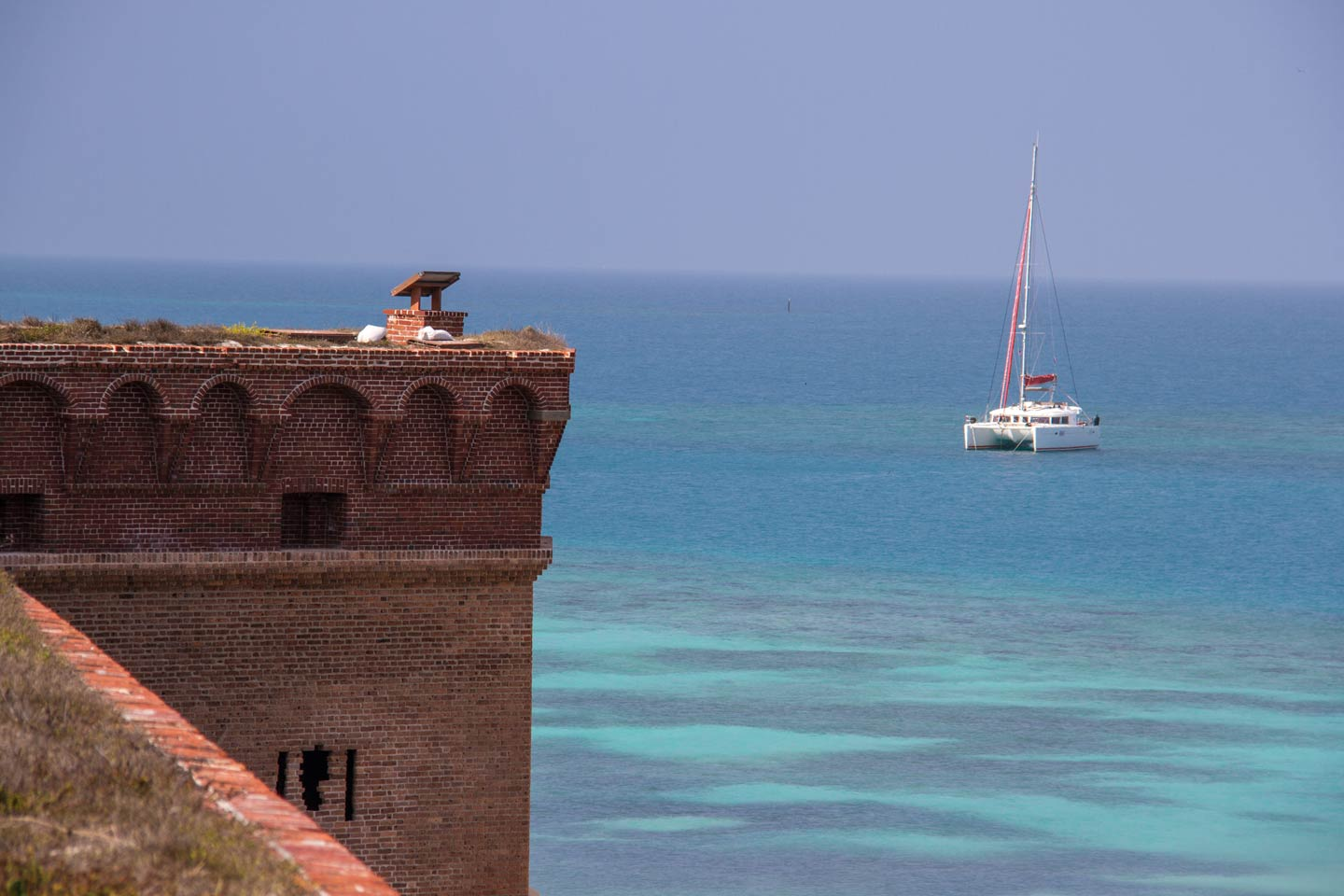 A view of a boat on the waters of Dry Tortugas from the Jefferson Fort