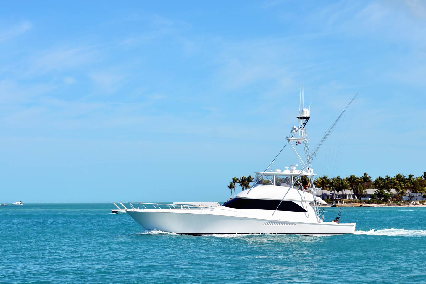 A white sportfishing yacht fishing in South Florida