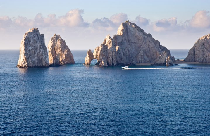 Charter Boat cruising past Los Arcos in Cabo San Lucas