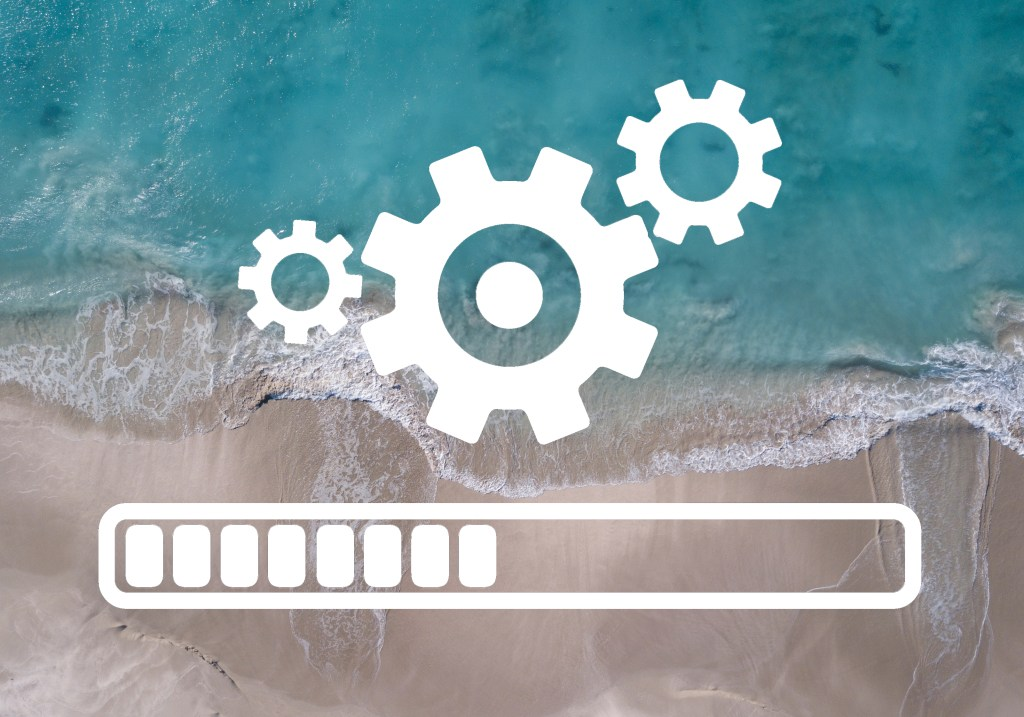 loading cog symbol with beach background