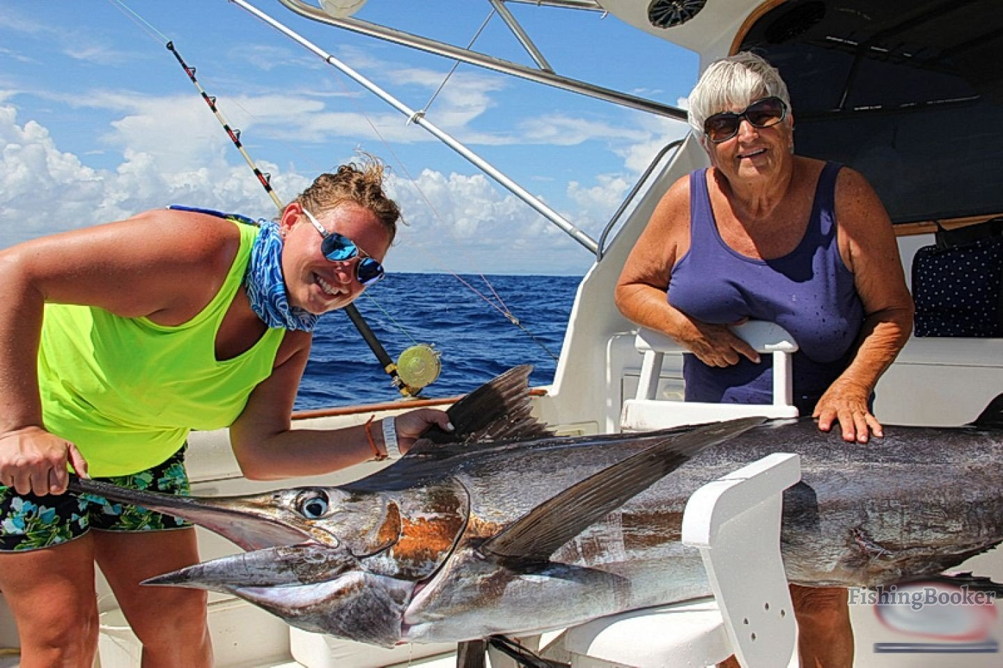 two ladies caught a marlin