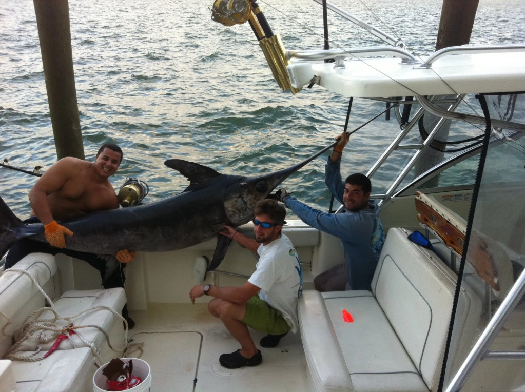 Capt Chris and Crew, catching a 350lb sword !!