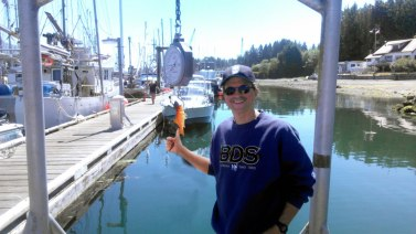 Weighing Goldfish on the dock in Tofino