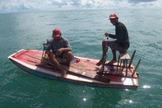 Neu (far right)on his friends boat, Neu's presence didn't improve his friends catch rate