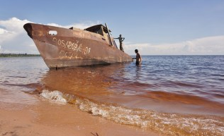 "Garrett fishing the ""structure"" on the beach at Lake Mweru"