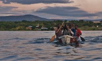Fishermen returning to shore at dusk