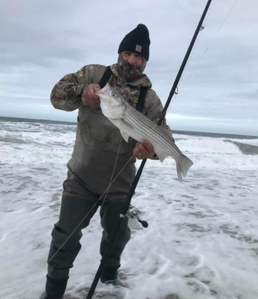 Here's JP with a striped bass he caught off of the LBI surf during this week's north east blow.