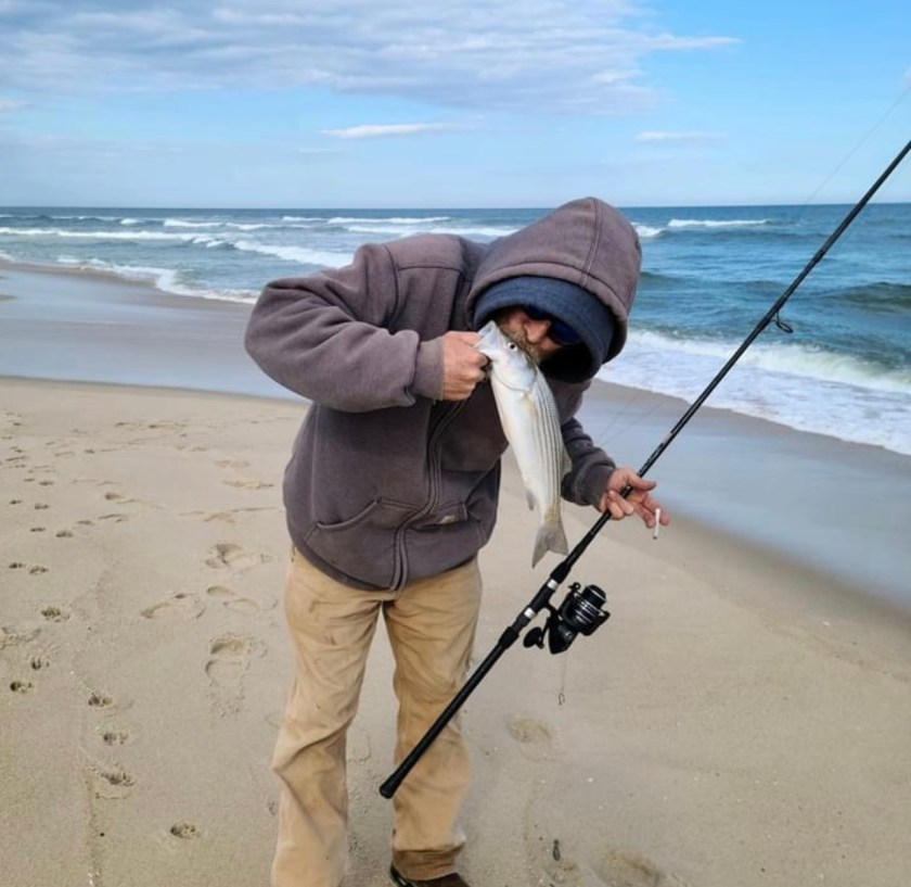 Frankie Lenetti caught this micro bass on the LBI surf. He gave it a kiss and set it back with a reminder to grow up and then come back once 50 pounds!