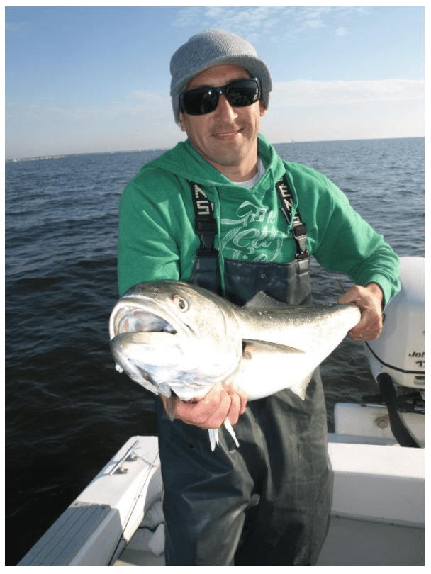 """A spring slammer caught on with a 7"""" popper by Jetty Ambassador Dave Werner in a few feet of water aboard the Debbie M."""