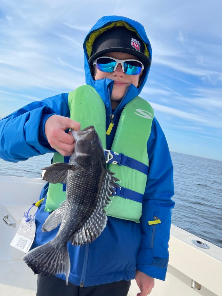 Here's 9 year old Quinn with one of many black bass he caught jigging aboard Fish Head Charters with Captain Greg. Quinn also caught a nice striped bass on a bucktail.