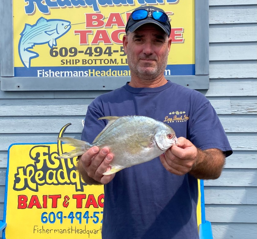 Here's Joe Handle with one of two pompano he caught off the Long Beach Island surf.
