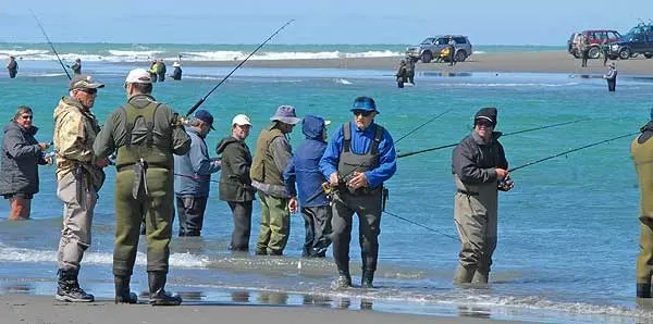 Waimakariri River trout and salmon.Pete Hart from New Brighton Sports - wearing white hat in forground - at the Waimakariri River mouth during the competition.