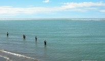 Salmon anglers at the mouth of the Waimakariri River, Canterbury, South Island of New Zealand.