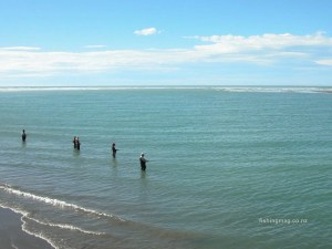 Desktop wallpaper of salmon anglers at the mouth of the Waimakariri River, Canterbury, South Island of New Zealand.
