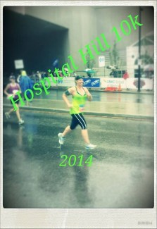 Sarah Grosko running in the rain at the Hospital Hill 10K (after running the 5K the night before).