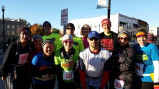 Run club members gather at the starting line of the Zombie 5K