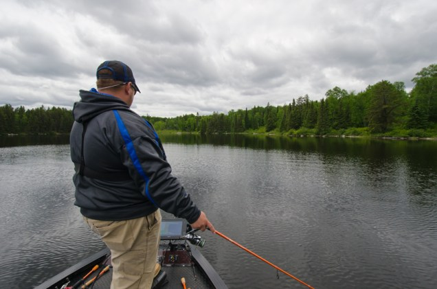 Danny Thompson from Garmin sifting through the northern Ontario water.