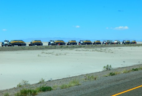 Also in June, 2017 this fleet of bottom dumpers waited in line during a construction project on Utah's salt flats on I-80.