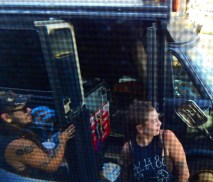 Piling out of the filthy bus. It's a good thing that the filth doesn't show in this photo. Check out the stylish nose ring and tattoos.