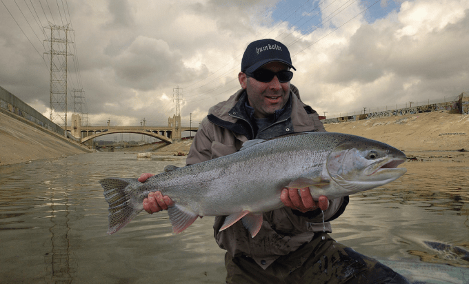 Action movie star-turned guide Jack Damon with a beautiful steelhead from the Los Angeles River