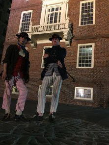 Note the stripes and sticks in the 'shore-going rig' of two recreated American merchant seamen, c. 1770s (Adam Hodges-LeClaire at left, Sean O'Brien at right), outside Old State House (Boston, Massachusetts (2015).