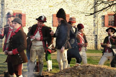 A sailor wearing a thrum cap amongst other members of the recreated Charles Wilson Peale's company of 2nd Battalion Philadelphia Associators (Old Barracks Museum, Trenton, New Jersey, 2015) [Photo credit to Todd Lacy].