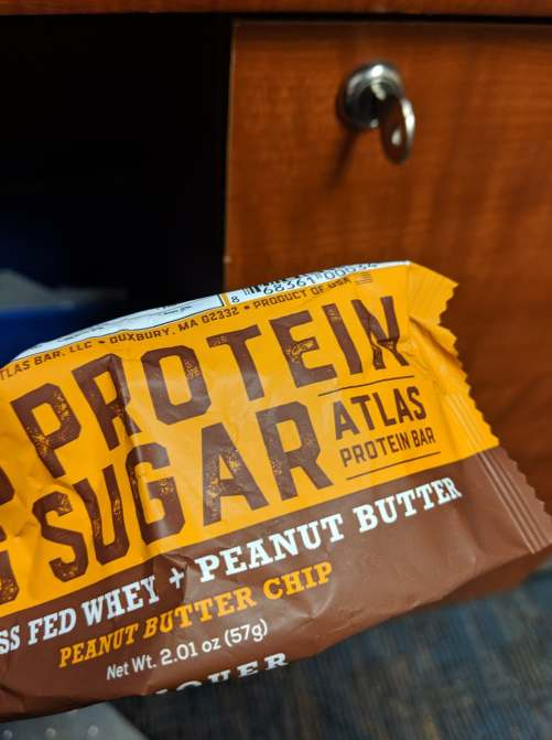 A wrapper for an Atlas Brand peanut butter protein bar