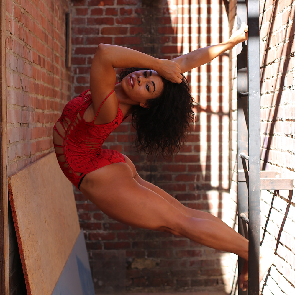 Woman bending body contortion alley ladder Fit & Bendy