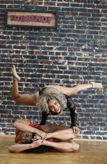 Women contortion flexibility training Fit and Bendy brick wall studio