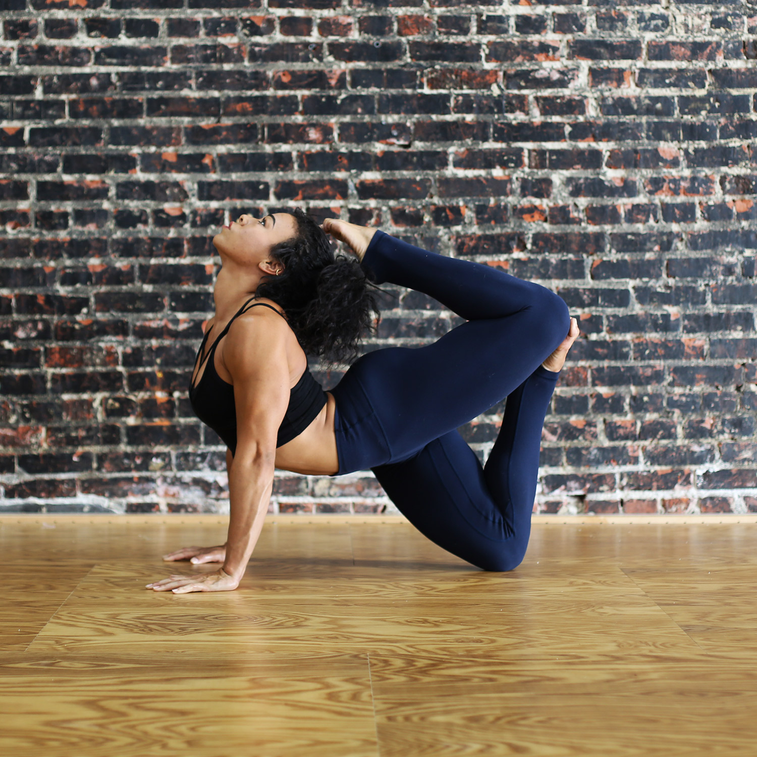 Lexi Powell Fit and Bendy Flexibility Instructor Brick Wall Wood Floor Contortion