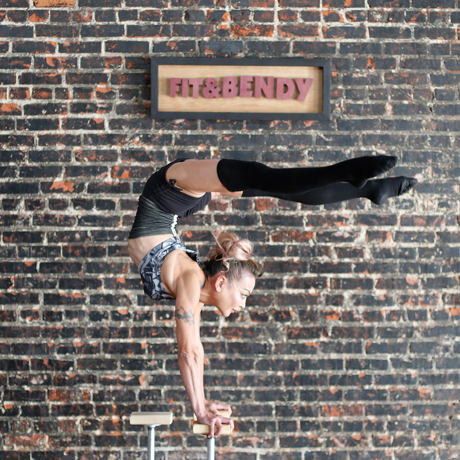 Lena Instructor Fit and Bendy Intro to Woman Contortion Handstand Flexibility Fitness Brick Wall