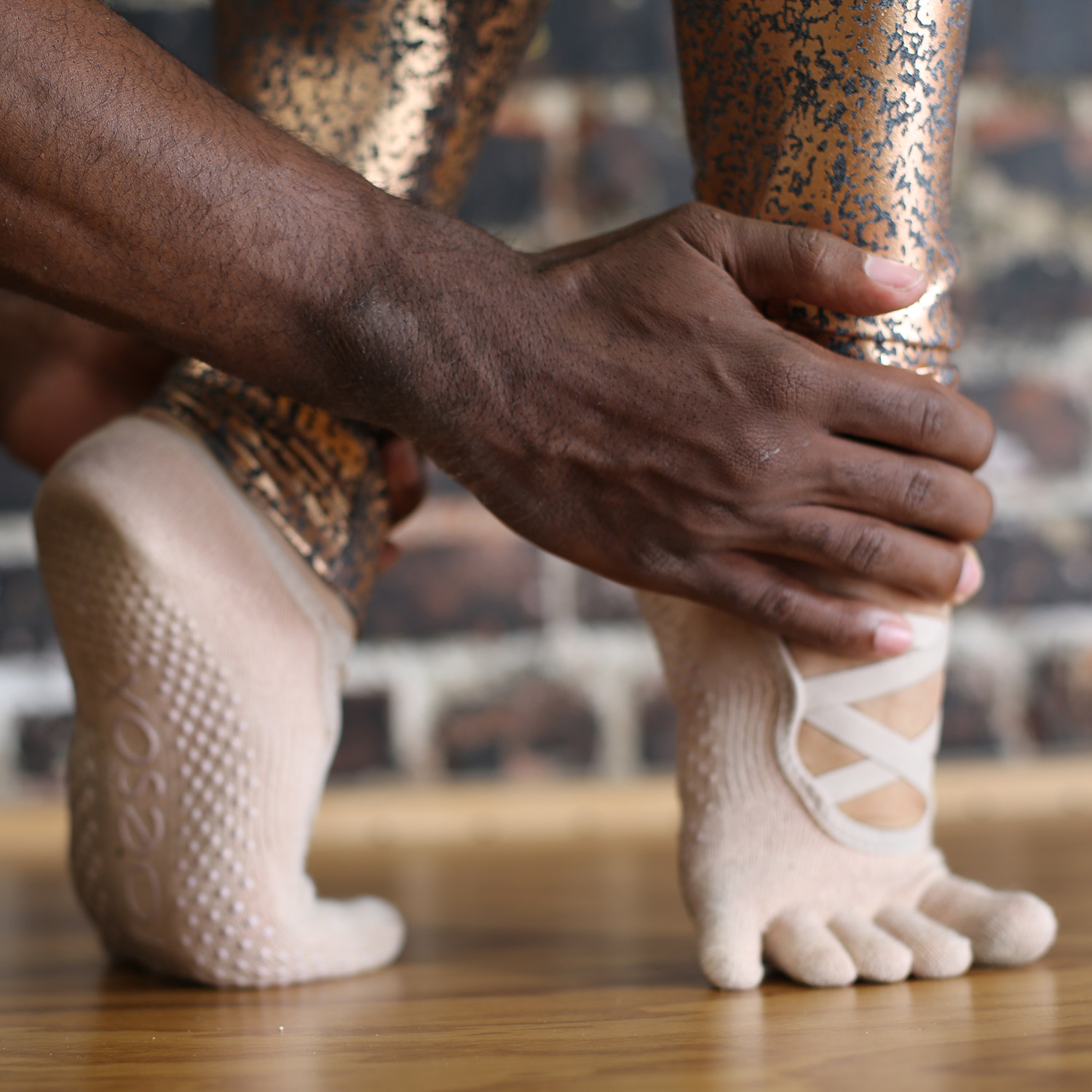Ballet Classes Fit and Bendy Man Holds Womans Feet