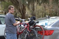 """J was the responsible one and put the bikes back on the car while I took pictures of the burn area. Notice his """"why are you taking my picture"""" face? Yeah, I snuck one of him too!"""