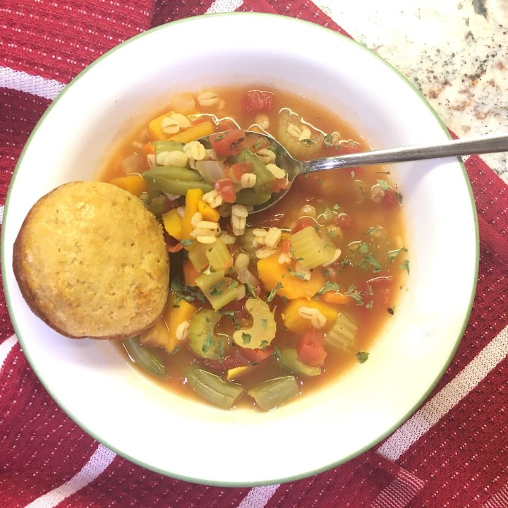 bowl of vegetable barley soup ready to eat