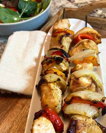 tasty chicken kabobs made with onion and peppers