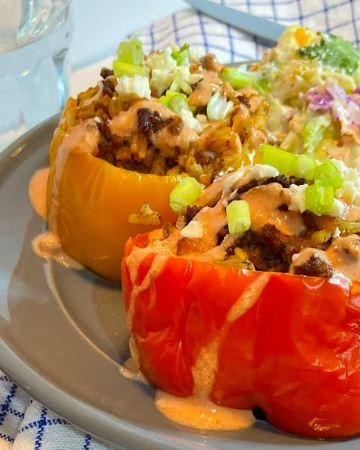Stuffed peppers with salad on plate