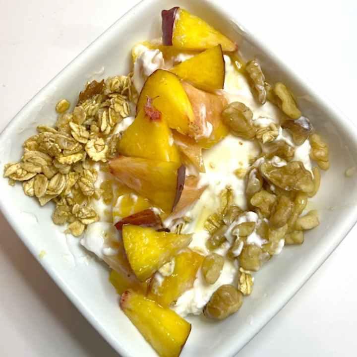 Greek yogurt with fruit and a bit of whole grain granola is a healthy mediterranean breakfast