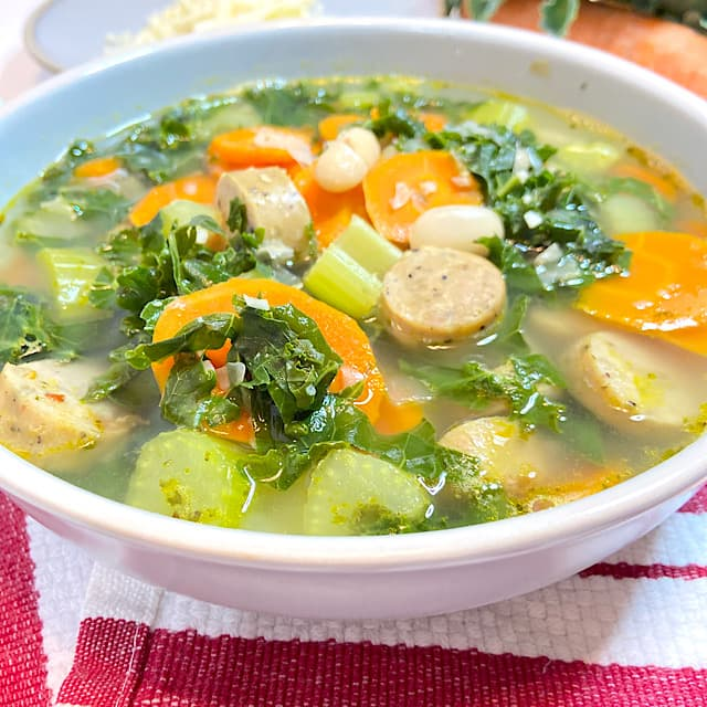 bowl of sausage and kale soup with vegetables