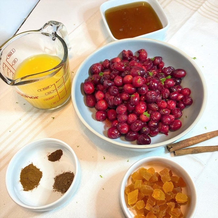 measured ingredients for cranberry sauce with orange
